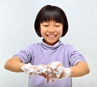 young girl washing her hands
